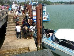 boarding the boat to Koh Mak at the krom luang pier in Laem Ngop